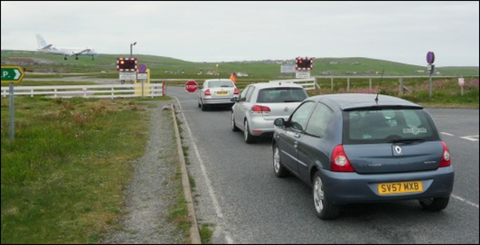 Level crossing with a difference, it`s across Sumburgh airport`s runway !