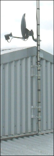 Mounting brackets and poles on the side of a metal clad building