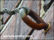Screw eye in use as a catenary wire anchor